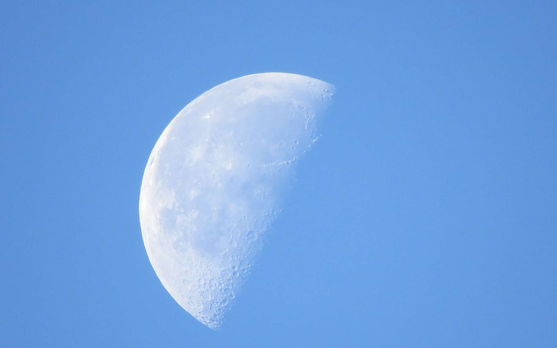 Why is the Moon visible in broad daylight?